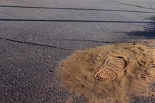 Handful Of Sand On The Pavemen...