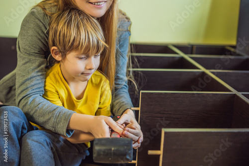 Mother and son assembling furniture Fototapet
