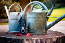 Close-Up Of Old Watering Cans ...