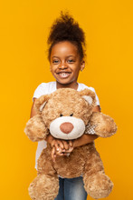 Pretty Afro Girl Holding Teddy...