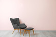 canvas print picture Stylish armchair near color wall in room
