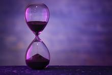 Hourglass On Dark Color Backgr...