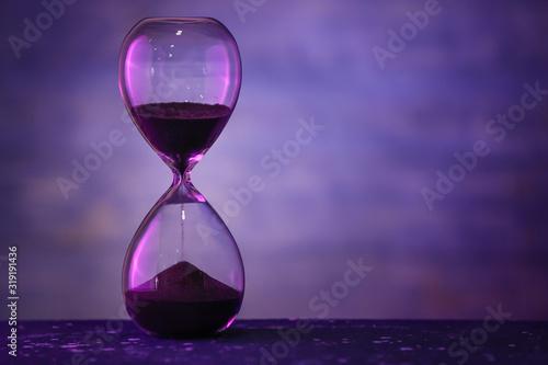 Obraz na plátně Hourglass on dark color background. Time management concept