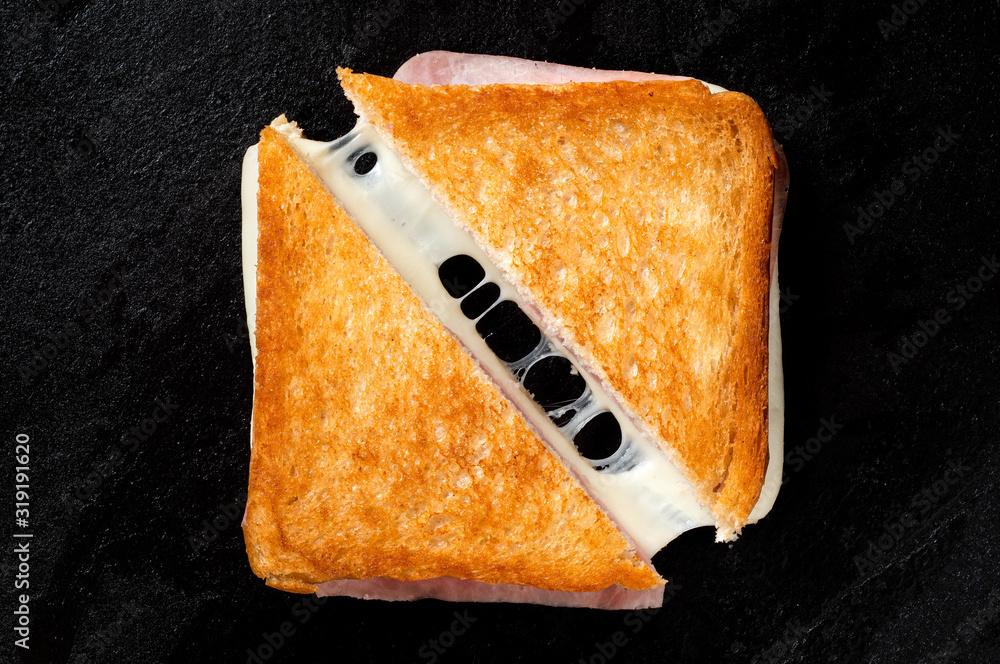 Obraz Cheese and ham toasted sandwich. fototapeta, plakat