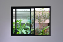 Glass Slide Window Replacement On White Wall Of A New House