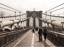 People Walking On Brooklyn Bridge Against Sky