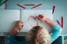 Little Girl Drawing Red Heart ...