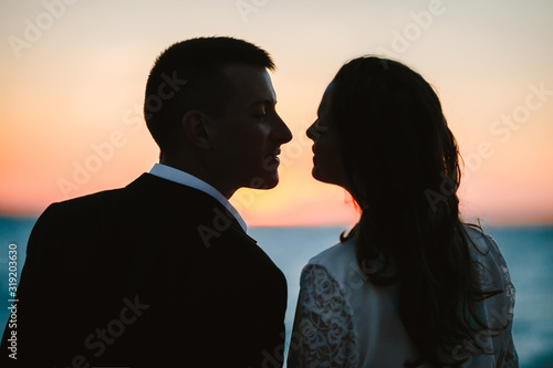 Happy smiled couple a moment before kiss in the picturesque evening dusk by the Canvas Print