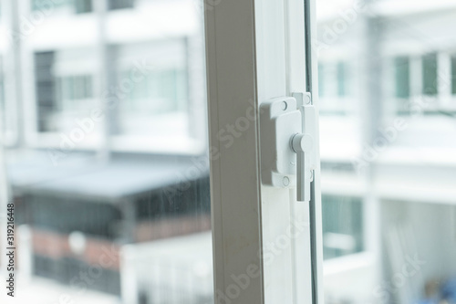 Window lock handle of modern home looking outside the house. Canvas Print