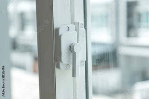 Window lock handle of modern home looking outside the house. Wallpaper Mural