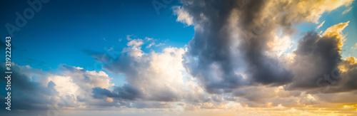 Obraz Dark clouds in a colorful sky at sunset - fototapety do salonu