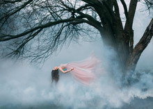 Woman Witch Floating In Air Ghost Butterfly. Luxury Long Pink Silk Skirt Fabric Dress Hair Waving Fly Wind. Cold Autumn Spring Bare Tree Backdrop. Enchanted Princess Lady Art Photo Magician Levitation