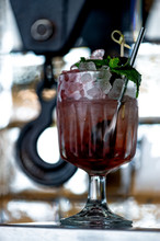 Bramble Cocktail On A Hook Background.