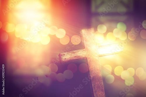 Fototapeta wooden cross decoreted in church under the ceremonial lighting