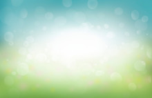 A Spring Background Of Blue And Green, Blurred Foilage And Sky With Bright Bokeh.