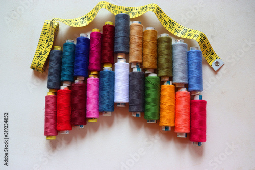 colorful spools of sewing thread on a white background Canvas Print