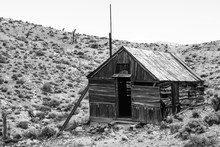An Abandoned Mining Cabin In The Middle Of The Desert