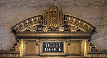 Ticket Office Ornate Bronze Sign Against A Brown Marble Wall In Chicago's Civic Opera House