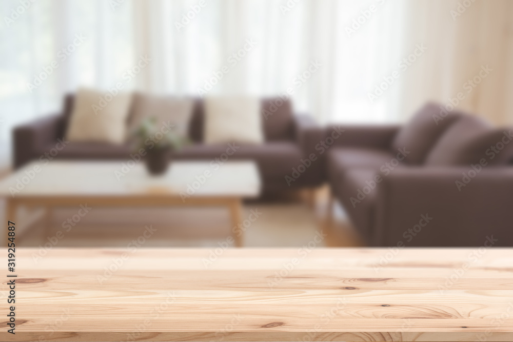 Fototapeta blur classic living room with sofa and wooden table top vintage home style for house products montage advertising background