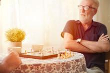 Smart Elder With Chess Board G...