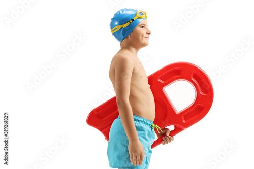 Obraz Boy in swimming trunks holding a swimming board - fototapety do salonu