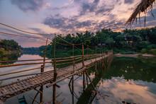 Bamboo Bridge At Sunrise In Laos