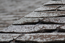 Old Worn Out Asphalt Shingles On The Roof Of A Residential Home.