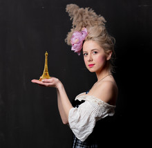 Beautiful Blonde Countess With The Eiffel Tower Statuette