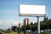 Big Billboard Standing In The City. White Advertising Field For Advertising. Mockup Billboard