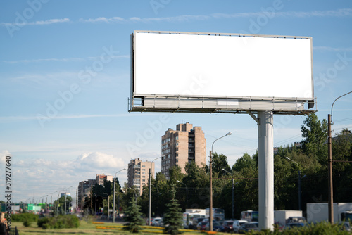 Fototapeta big billboard standing in the city. white advertising field for advertising. Mockup billboard obraz