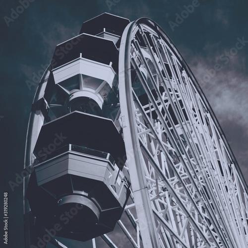 Beautiful shot of a white Ferris wheel in the amusement park Canvas Print