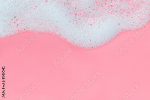 Pink foam bubbles on pink background