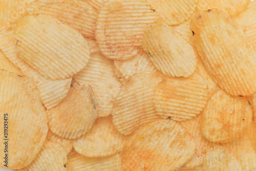 Fényképezés Potato corrugated chips texture background
