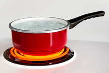 Red Pan With Boiling Water