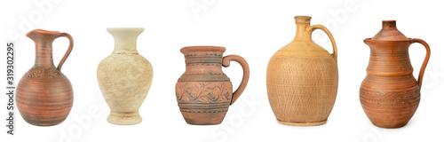 Fototapeta Set clay and ceramic jugs isolated on white obraz