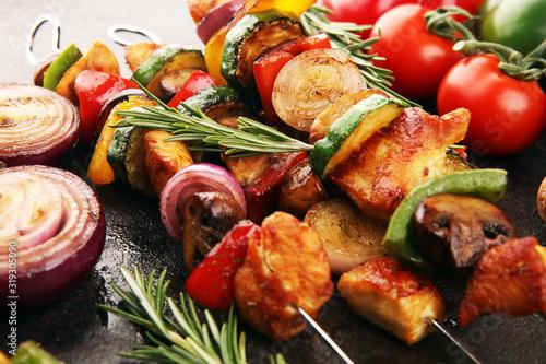 Cuadros en Lienzo Grilled pork shish or kebab on skewers with vegetables