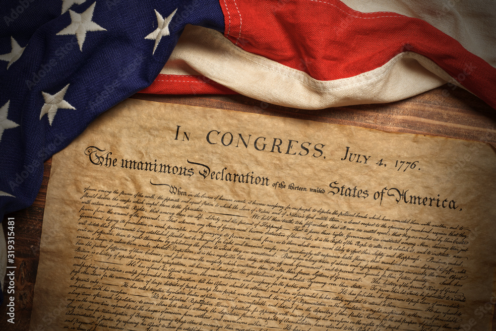 Fototapeta United States Declaration of Independence with a vintage American flag