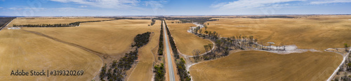 Aerial panoramic image of the South Coast Highway cutting through the drought af Wallpaper Mural