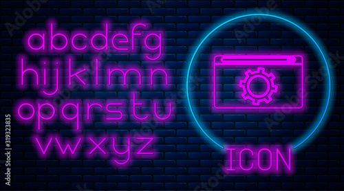Photo Glowing neon Setting icon isolated on brick wall background