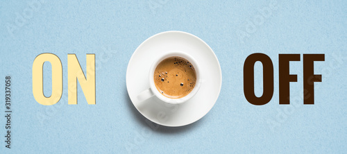 cup of coffee and cubes with text ON and OFF on paper background Wallpaper Mural