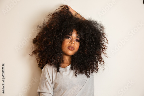 Beauty portrait of african american woman with afro hairstyle and glamour makeup Canvas Print