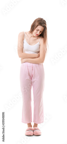 Young woman suffering from stomachache on white background Fototapet