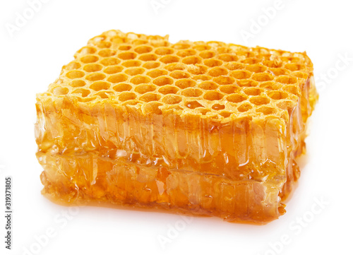 Honeycomb with honey on white background Wallpaper Mural