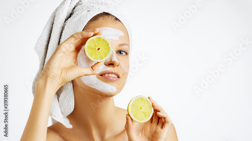 Fototapety, obrazy: Cosmetology, skin care, face treatment, spa and natural beauty concept. Woman with facial mask holds lemons.