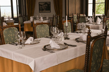 Interior Of A Classic Restaurant In An Old Castle. Traveling In Europe. Served Tables And Antiquity