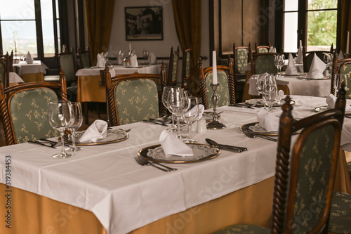 Obraz Interior of a classic restaurant in an old castle. Traveling in Europe. Served tables and antiquity - fototapety do salonu