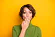 Leinwandbild Motiv Closeup photo of beautiful lady close mouth arm eyes full of fear terrified expression said bad wrong thing wear casual green turtleneck isolated yellow color background