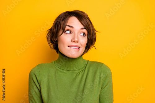 Oops. Closeup photo of beautiful lady ignoring expression said bad wrong thing look side empty space biting lips wear casual green turtleneck isolated yellow color background