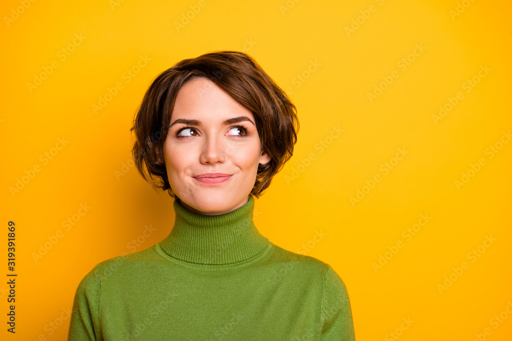 Fototapeta Closeup photo of funny short hairdo lady charming smiling good mood looking side empty space sly eyes wear casual green warm turtleneck isolated yellow color background
