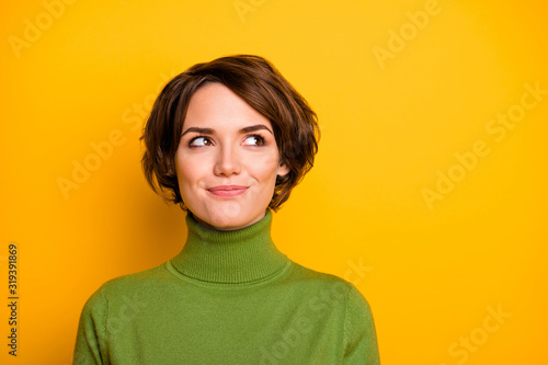 Fototapeta Closeup photo of funny short hairdo lady charming smiling good mood looking side empty space sly eyes wear casual green warm turtleneck isolated yellow color background obraz